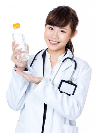 Asian doctor hold water bottle